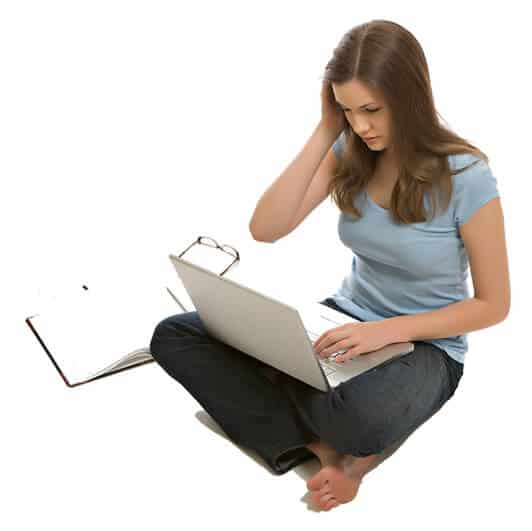 Picture of a girl reading off her laptop